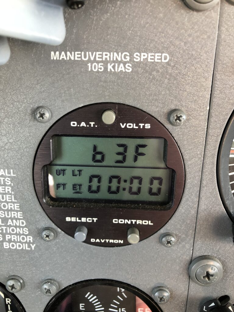 Outside air temperature gauge, displaying 63 degrees F.
